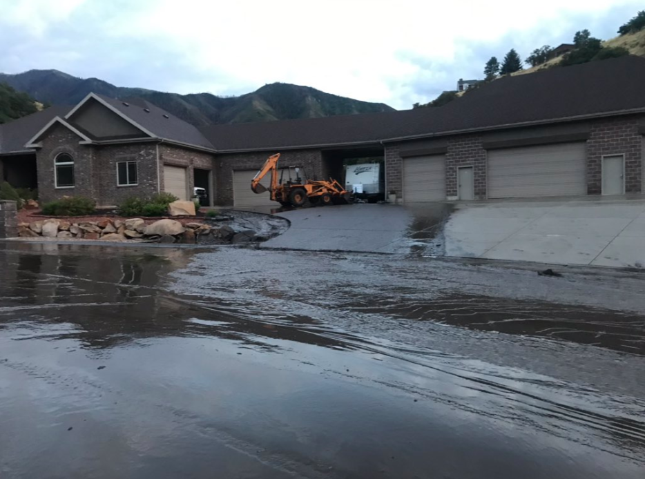 Neighbors in the Loafer Canyon area of Elk Ridge have begun a lengthy clean-up process after flash flooding and mudslides damaged homes and roads. (Photo: Jeremy Harris / KUTV)