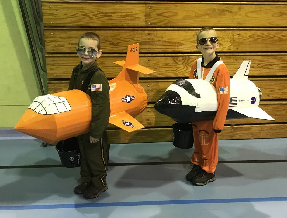 "Wyatt Woodruff (6) in the Bell X-1 ""Glamorous Glennis"" and Colt Woodruff (6) in the Space Shuttle Endeavor. From Brooksville, KY - Deayna Woodruff"
