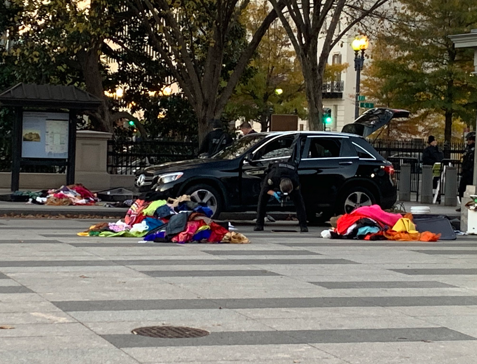 Secret Service Agents continue to dig through piles of clothing removed from a Mercedes SUV inside White House barriers.{&nbsp;} Thursday, Nov. 21, 2019. (Sam Sweeney/ABC7){&nbsp;}<p></p>