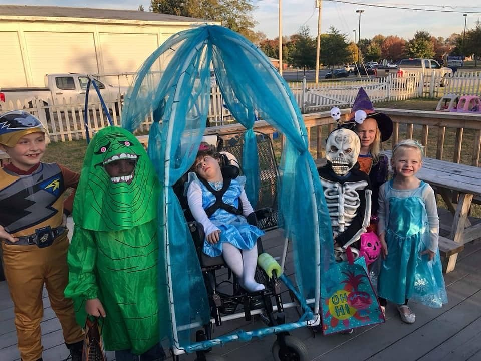 Jordynn Daulton age 5 has cerebral palsy her wheelchair was made into a Cinderella carriage for her by Ashley Collier