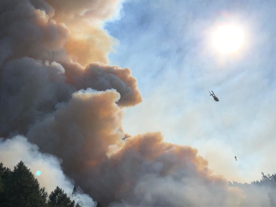 Firefighting helicopters attack the MP 97 Fire off I-5 south of Canyonville, Oregon. (ODOT/CC by 2.0)