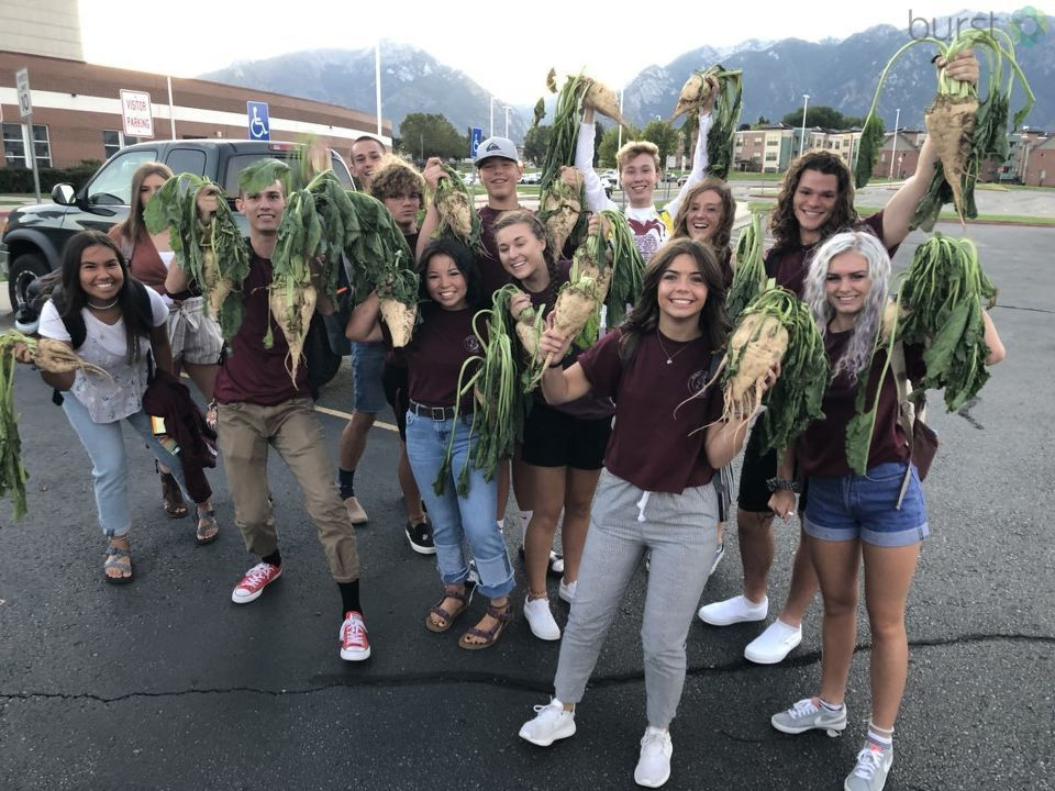 Jordan High School student leaders and new teachers each took a bite out of sugar beets Monday to honor the first day of school. (Photo: Michael Locklear / KUTV)