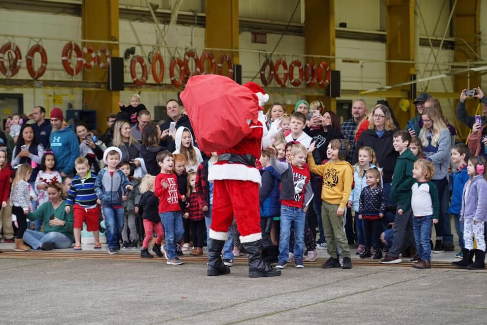 Santa ditched the reindeer for a helicopter on Dec. 14, 2019 when he visited children at U.S. Coast Guard Sector North Bend. Photo courtesy U.S. Coast Guard