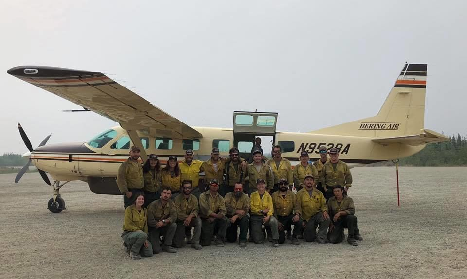 Pictured is the Medford Crew 10 BLM hotshot team lined up in front of a plane, ready to return home. They spent two weeks in Alaska helping fight the numerous wildfires that intense lightning storms caused. (Courtesy Medford Crew 10){ }
