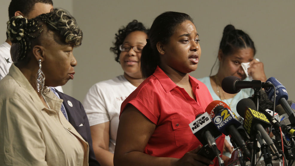 Eric Garner's daughter Erica Garner, center is joined by his mother Gwen Carr, left,  second from left, daughter Emerald Snipes, second from right, and wife Esaw Snipes, as she speaks during a news conference, Tuesday, July 14, 2015, in New York.(AP Photo/Mary Altaffer)