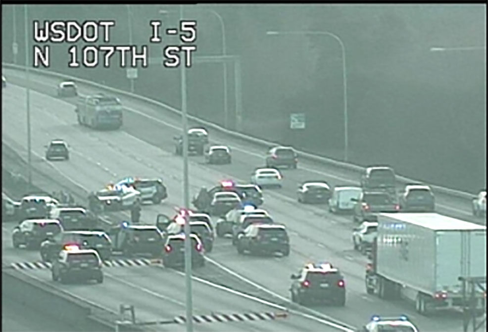 A suspected armed robber led police on a chase ending in a crash on I-5. (KOMO News photo)