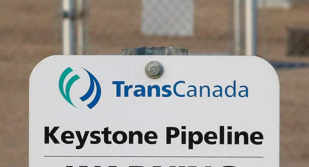 FILE- This Nov. 6, 2015, file photo shows a sign for TransCanada's Keystone pipeline facilities in Hardisty, Alberta.  (Jeff McIntosh/The Canadian Press via AP, File)